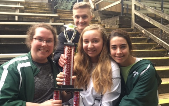 Photo of students holding a trophy