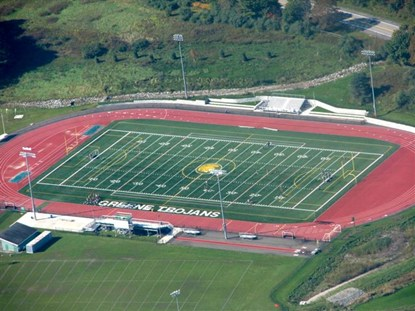 Aerial photo of the turf field and track at Greene Central School