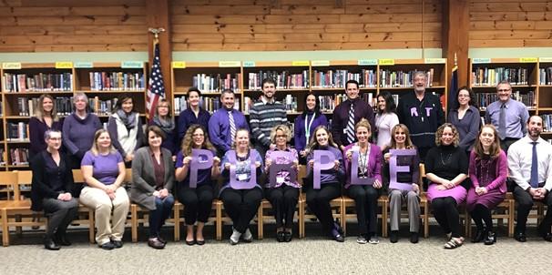 photo of high school staff wearing purple