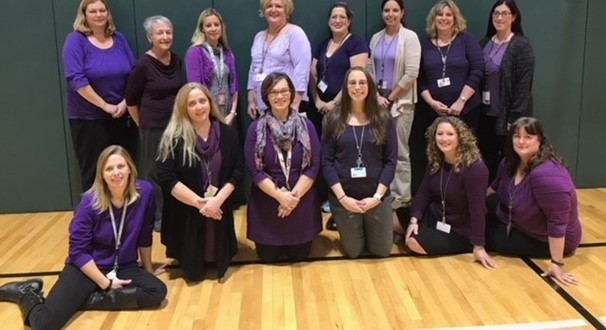 photo of Primary School Staff wearing purple in the gym