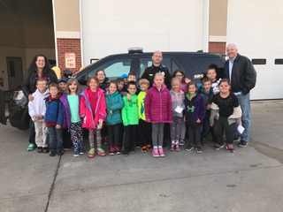 Second grade visits the police and fire department