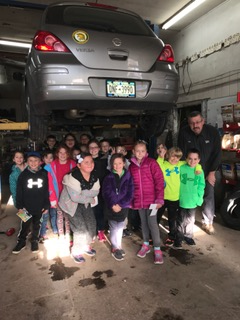 Second grade walking tour visits Wrench's Automotive