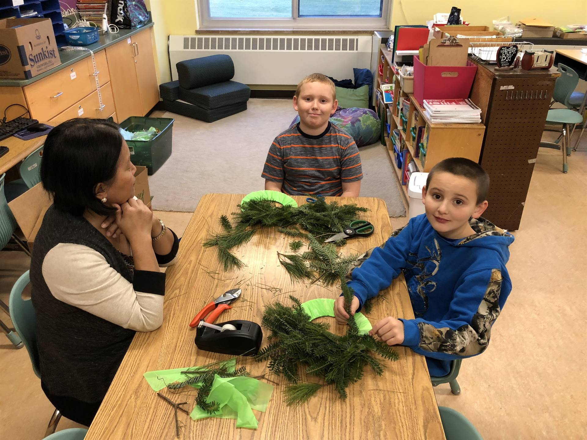 Students making wreaths