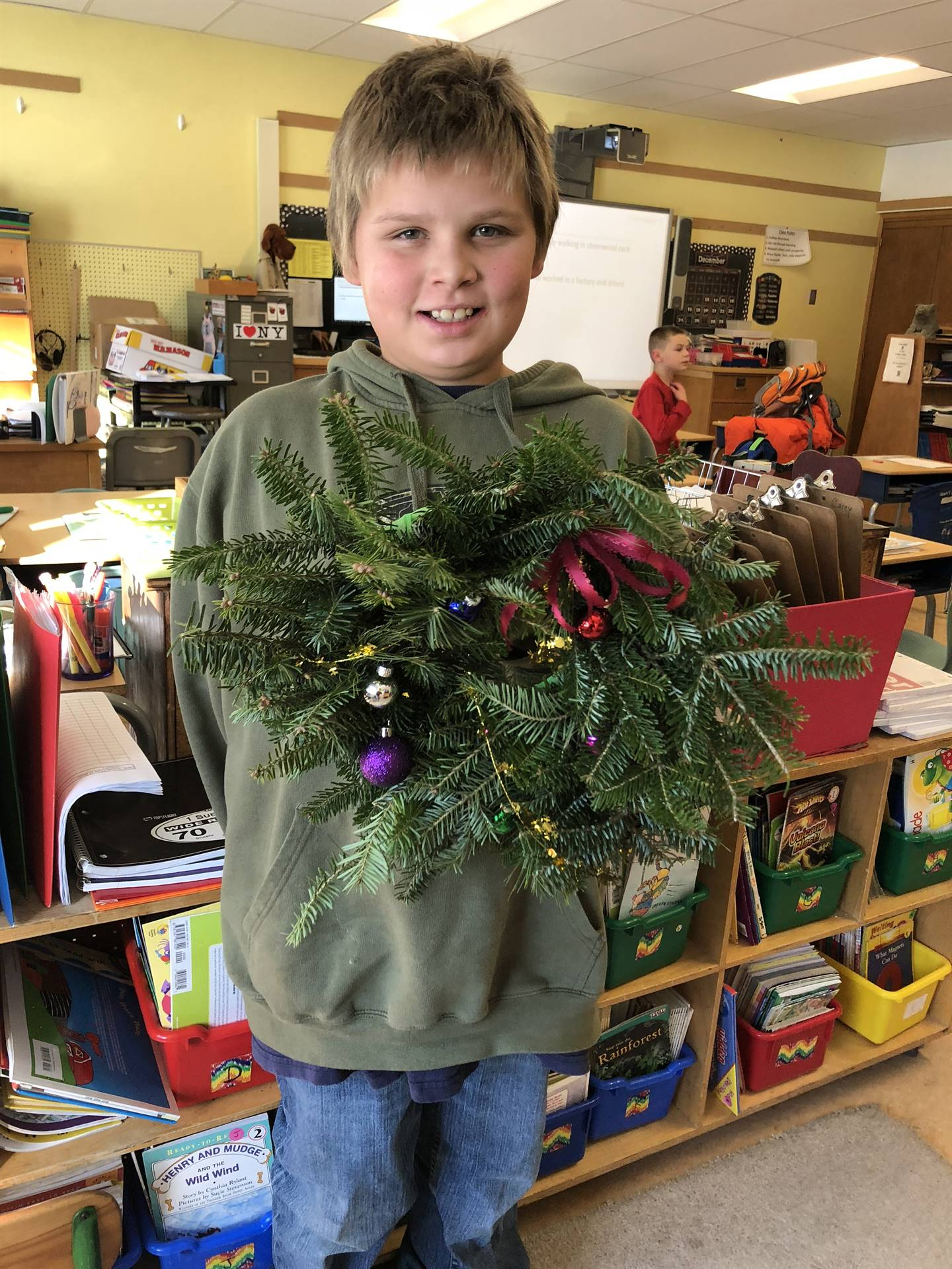 Student with their wreaths