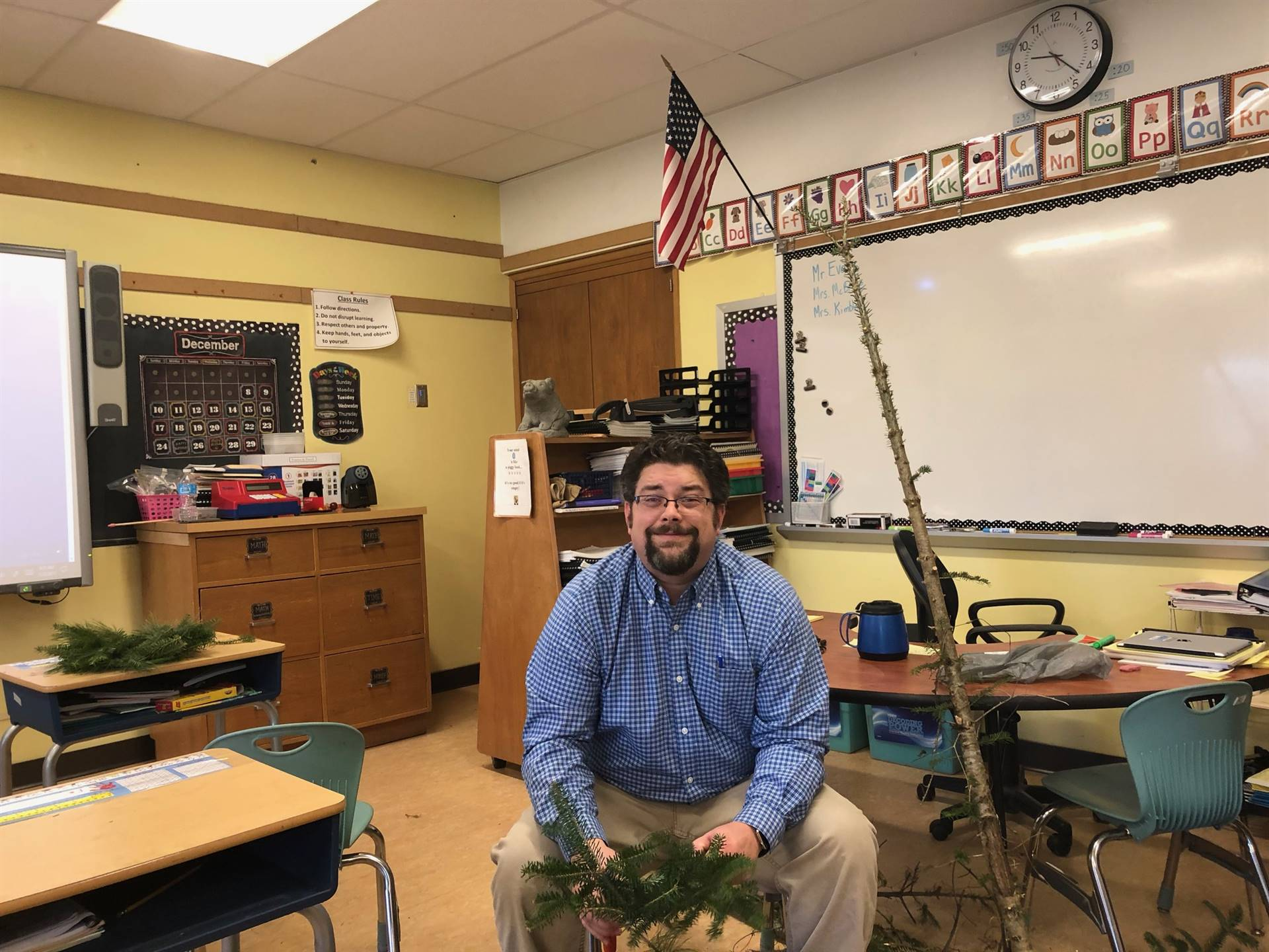 Mr. Evans cutting the branches for the wreaths