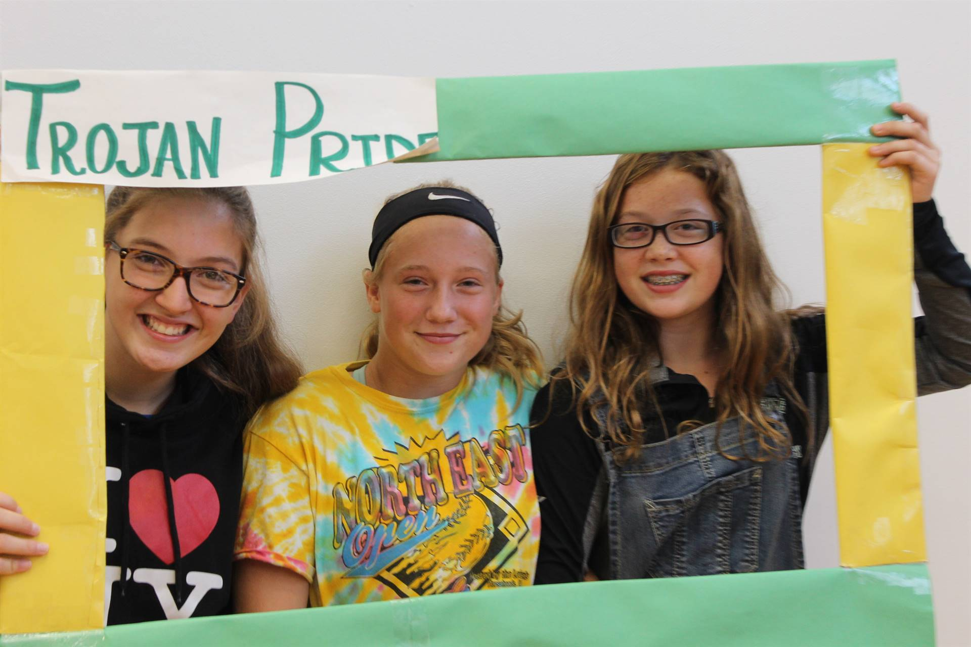 photo of middle school students in a trojan pride frame