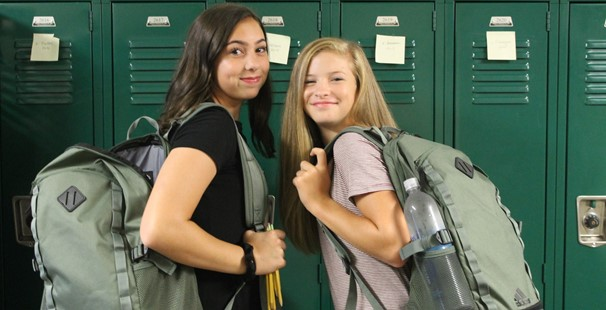 photo of two middle school girls standing in front of lockers