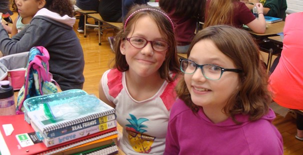 photo of two middle school girls sitting in the cafeteria