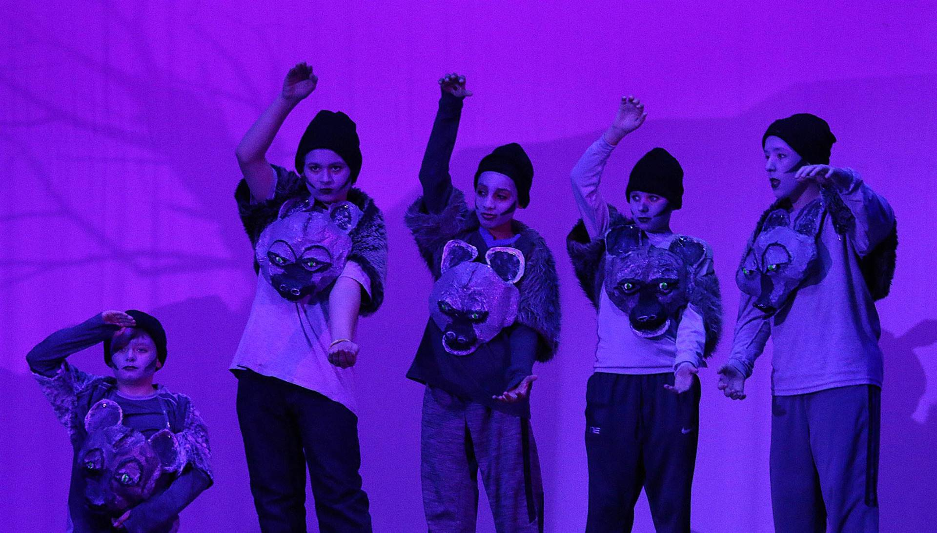Five boys in Hyena costumes for the Lion King play