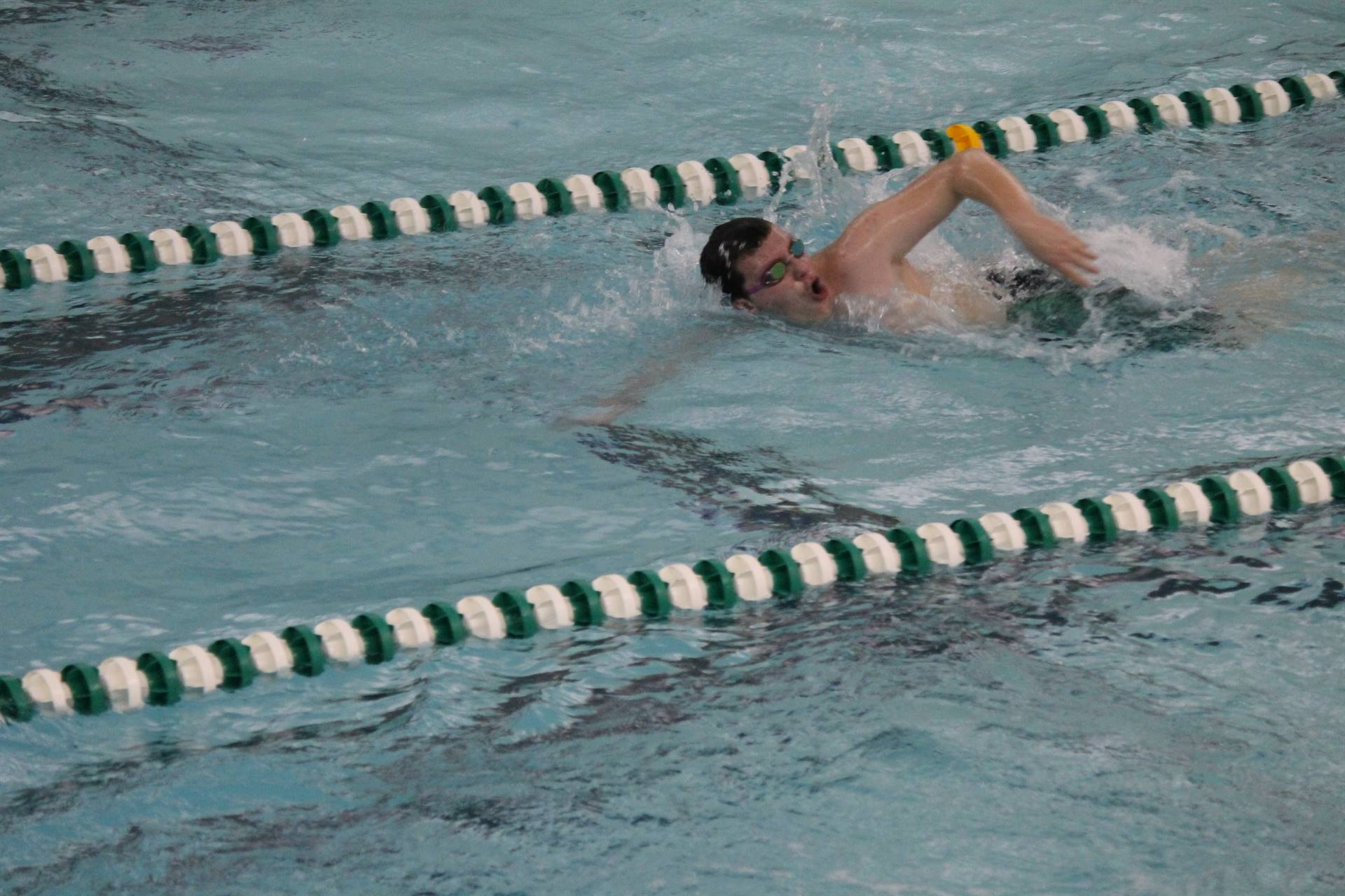 Boy doing breast stroke during swim meet