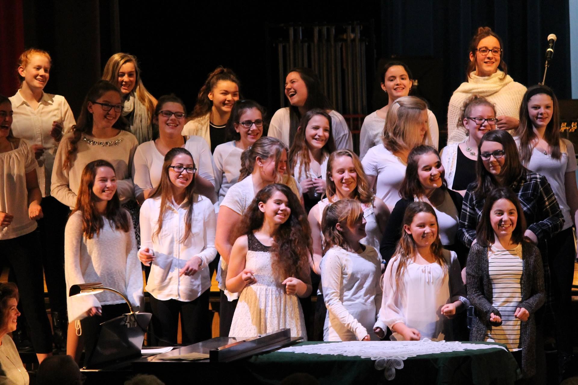 Girls Chorus laughing during concert
