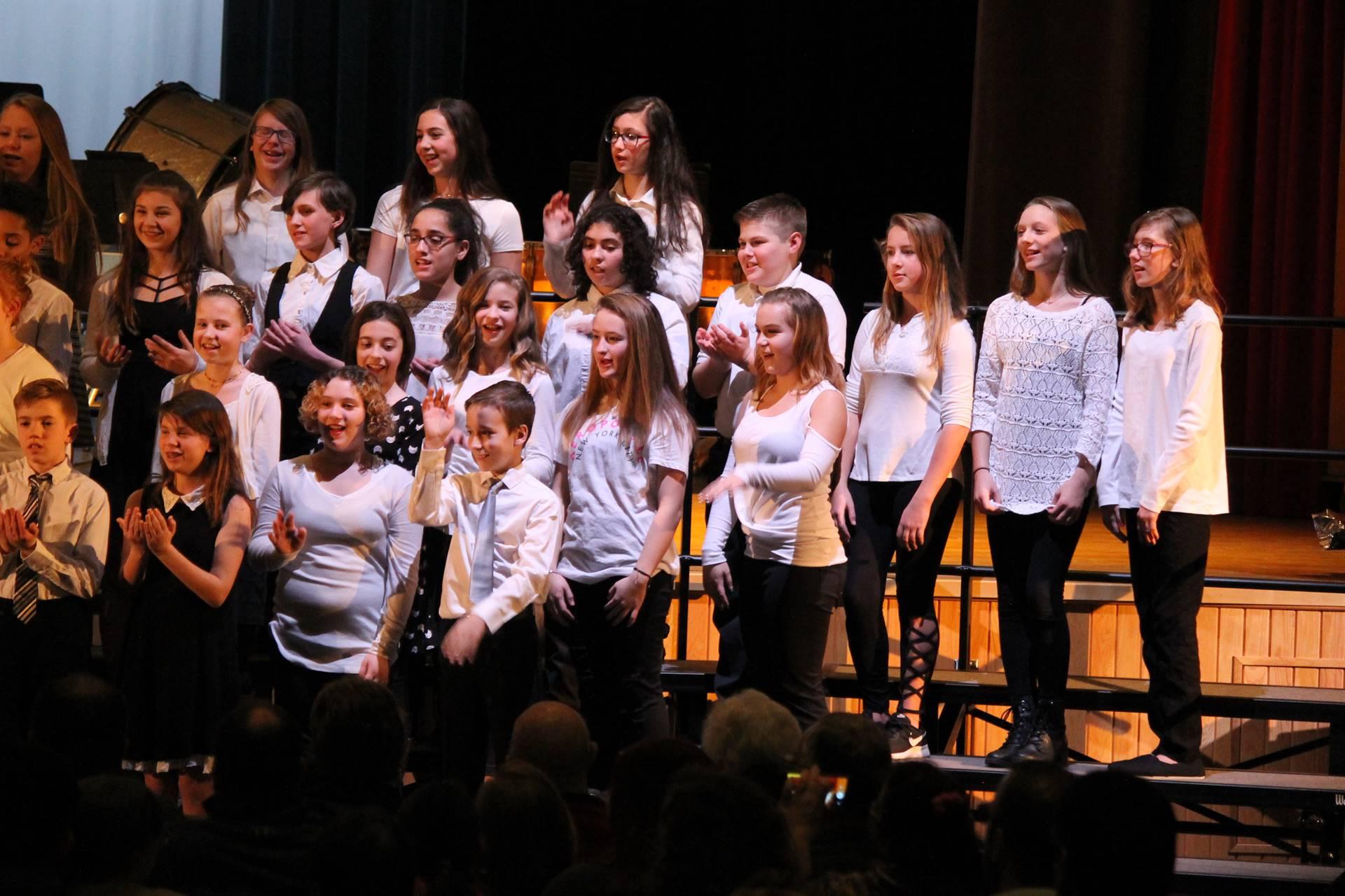 Girls singing at concert