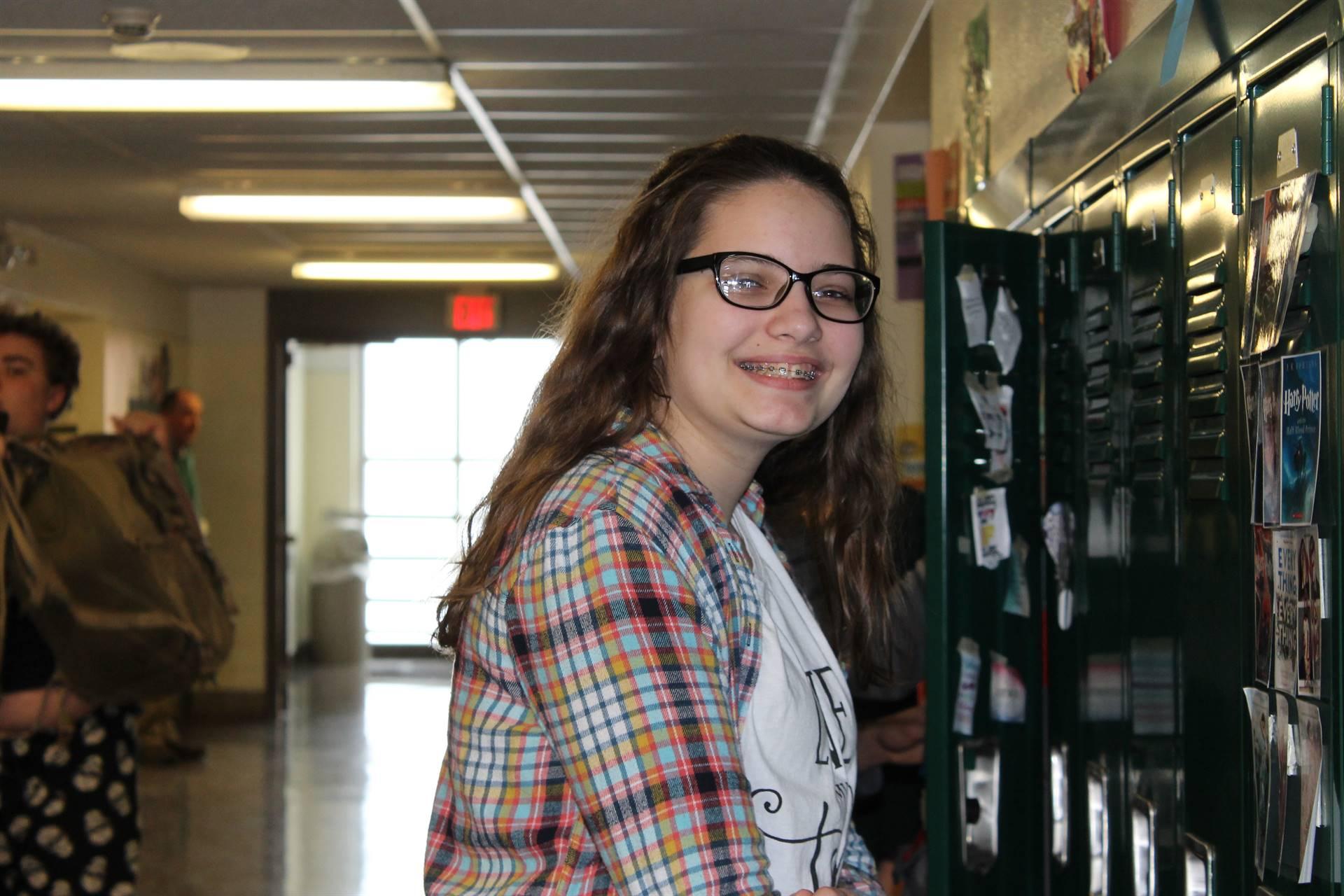 Girl standing at her locker