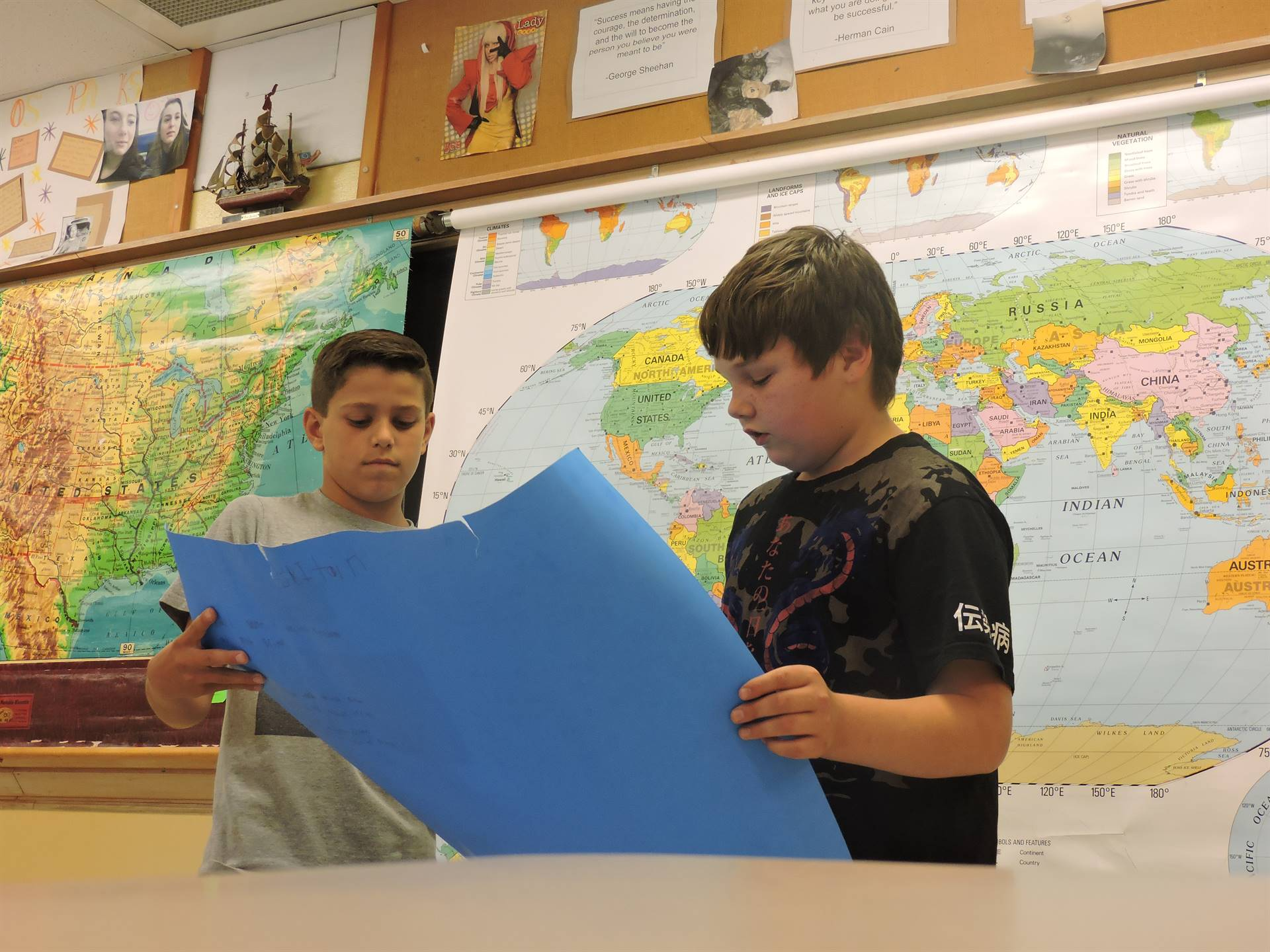 2 6th graders presenting their history poster/project