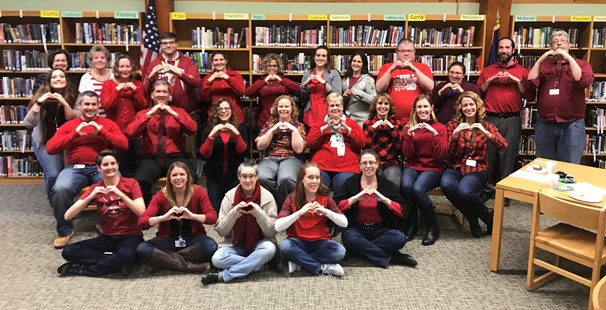 Photo of high school teachers wearing red in support of healthy hearts