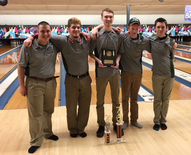 Photo of Varsity Boys Bowling Team holding trophies