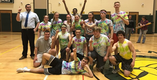 photo of senior students in tie-died shirts celebrating in gym