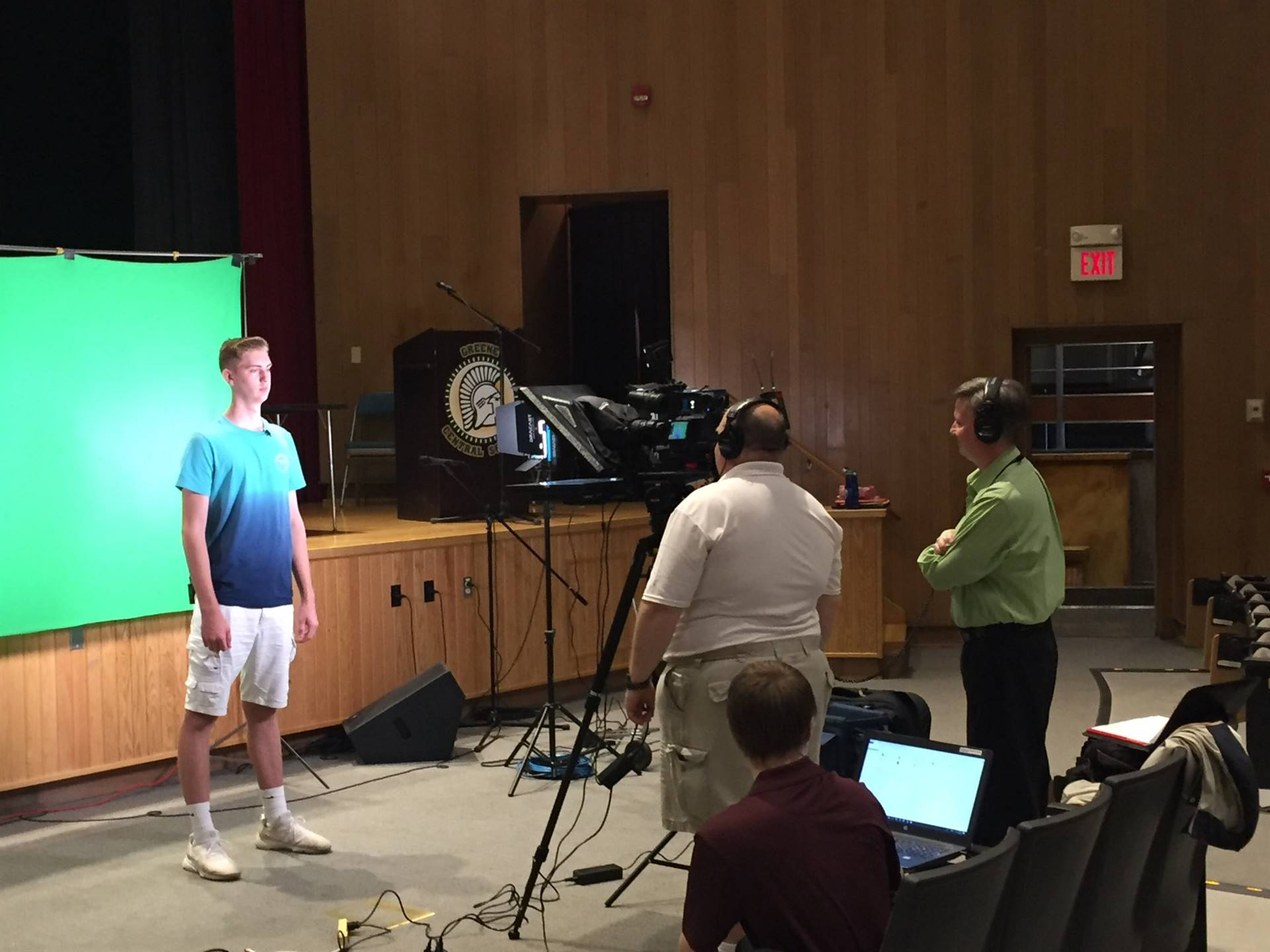photo of male high school student recording PSA