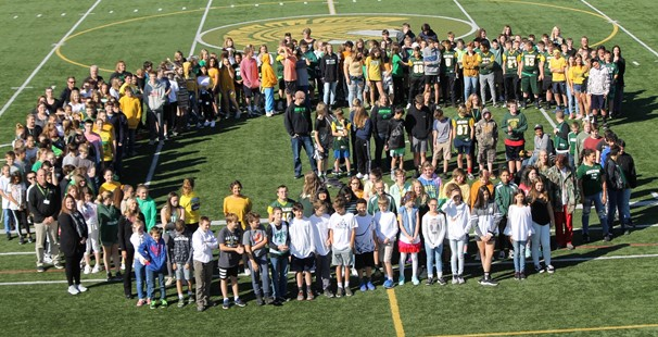 Photo of MS students forming a G on the turf