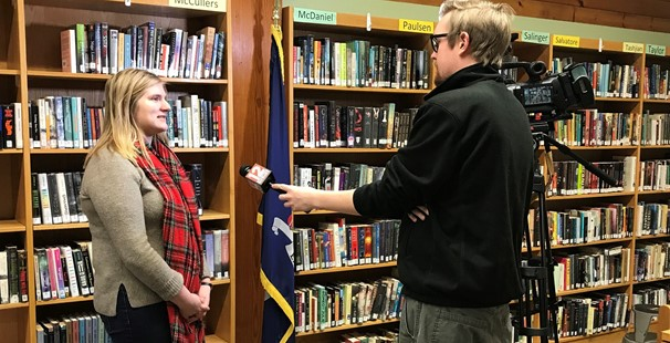 High school student being interviewed by a reporter