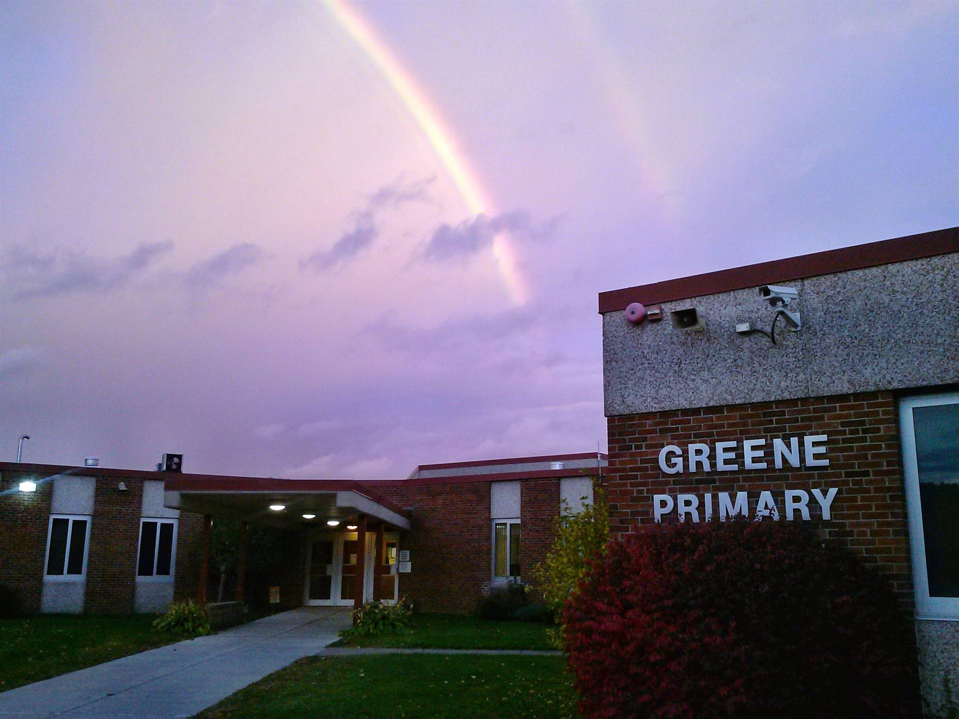 Photo of a rainbow over the Greene Primary School