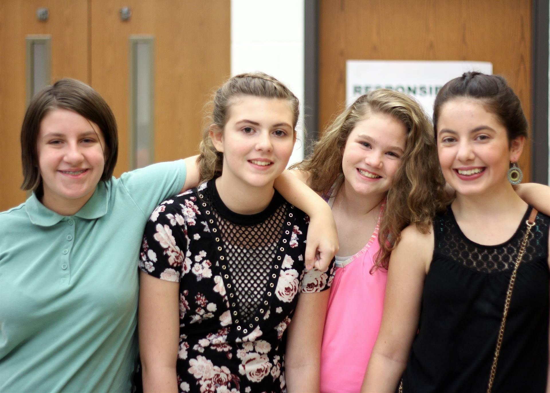 four girls at a school dance