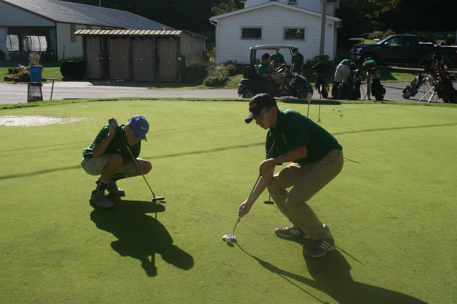 Two boys golfing