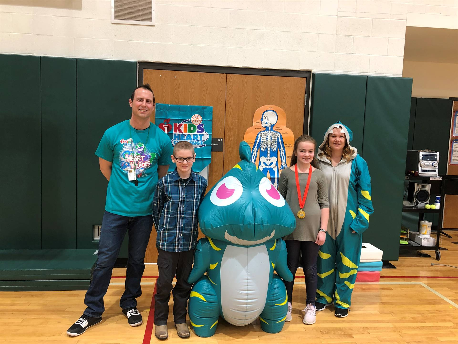 Photo of intermediate students and staff with healthy heart mascot