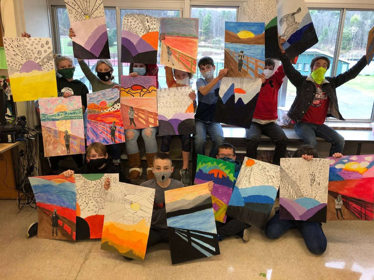 Photo of Mrs. Olbrys' middle school art class with drawings