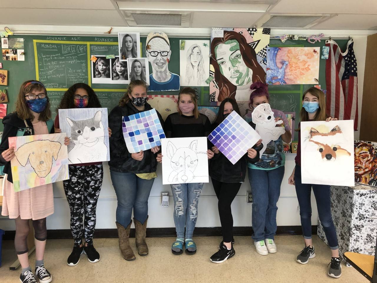 Photo of Mrs. Olbrys' Studio Arts students and their works