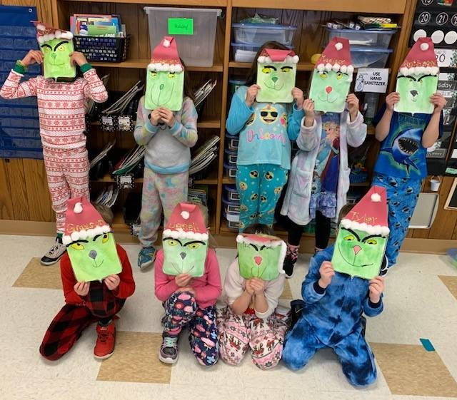 Photo of Mrs. Blakeslee's class with Grinch masks