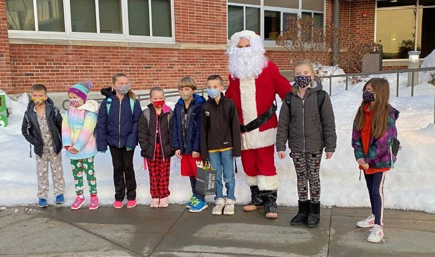 Photo of Santa Claus in front of Middle School with some students