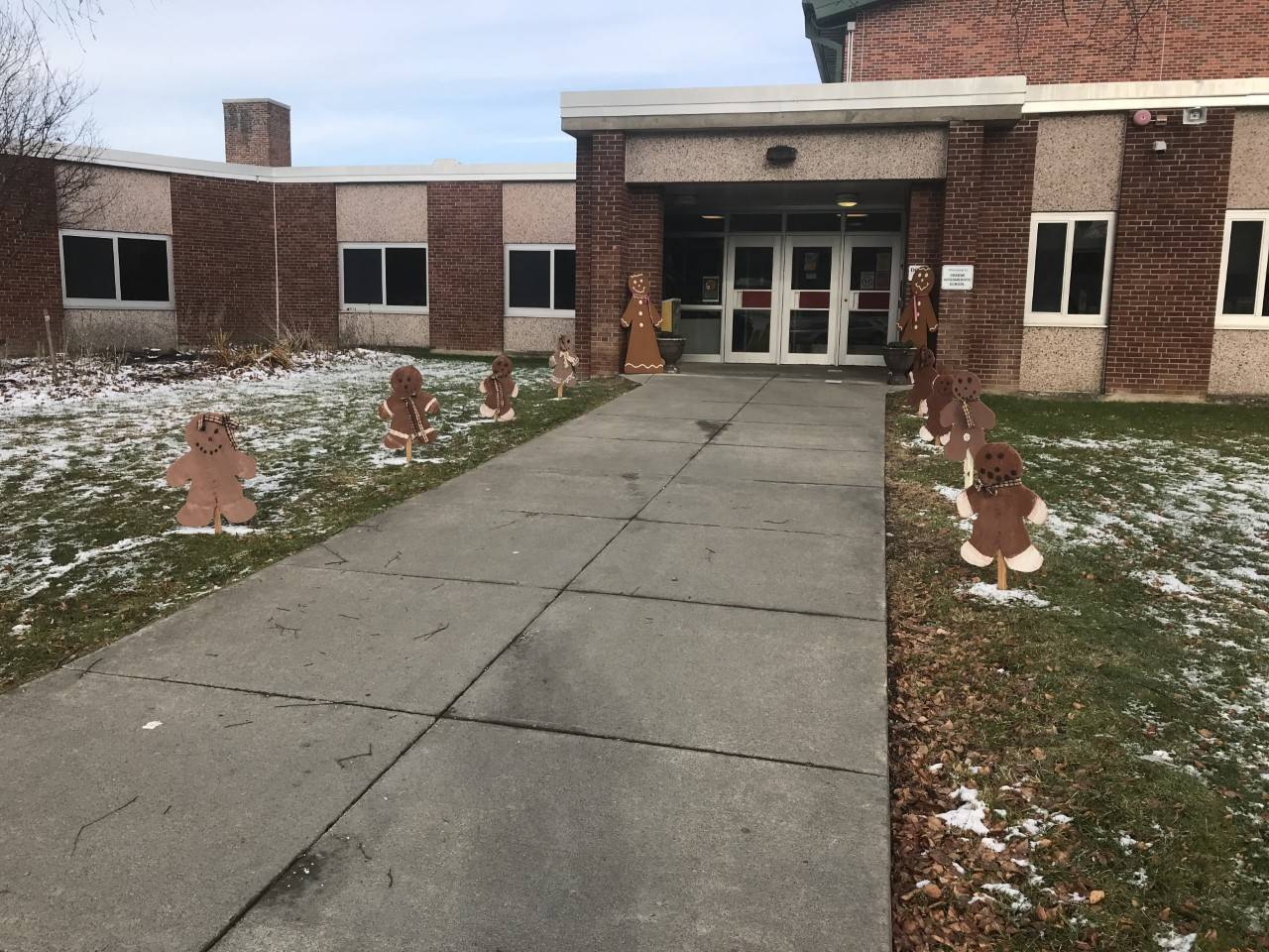 Photo of gingerbread people in front of Intermediate School