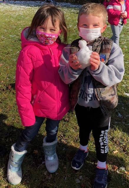 Photo of Mrs. Blakeslee's students making a miniature snowman