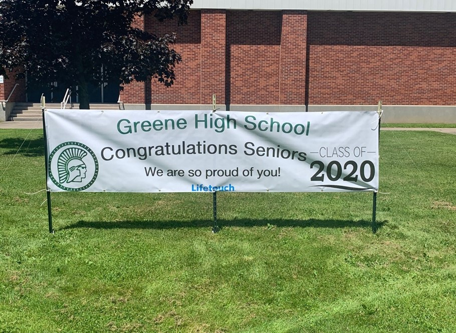 Photo of Senior Banner in front of school