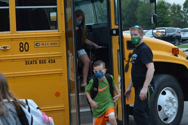 Intermediate Students Getting Off Bus on 1st day photo