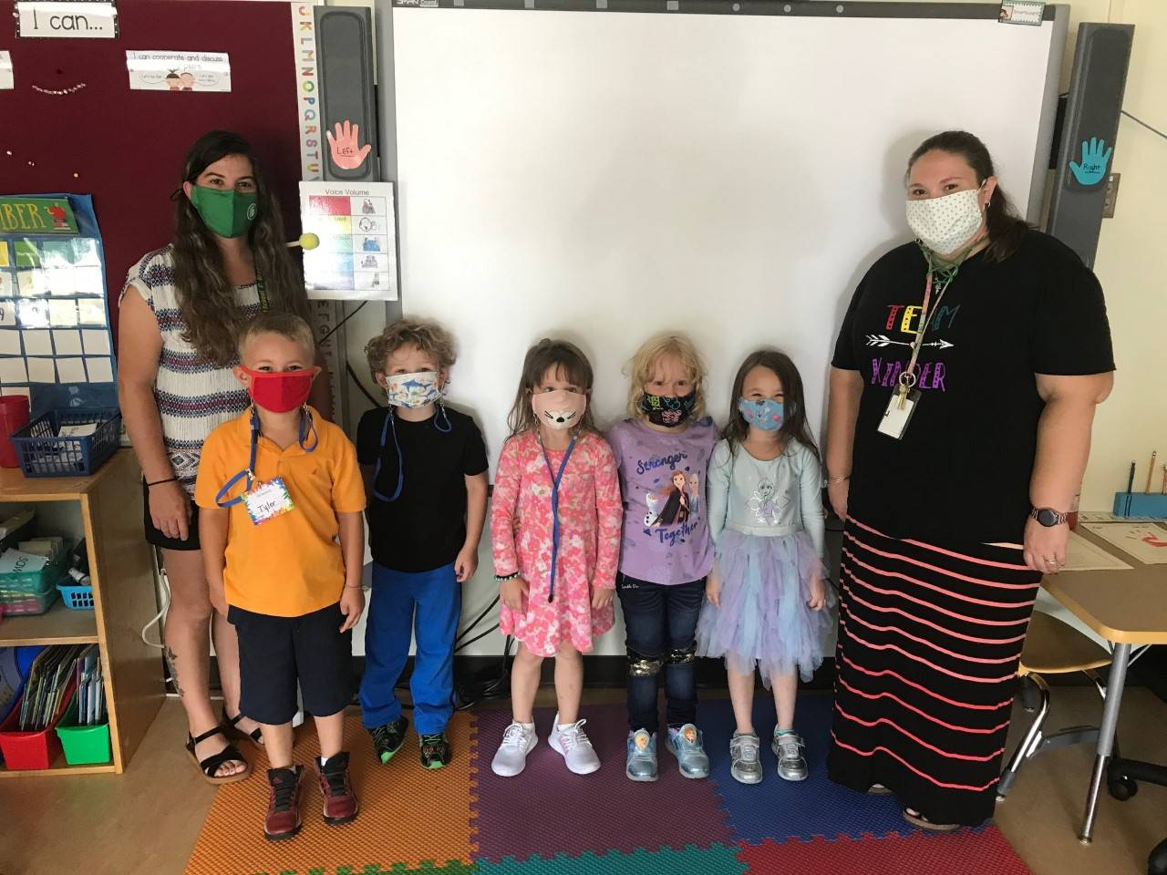 Photo of kids Mrs. Kinter's kindergarten class on first day with Aide Mrs. Dunlap