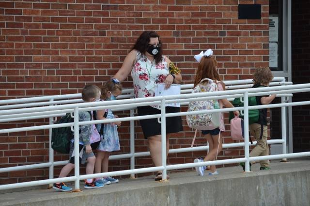 Picture of Primary students coming to school on first day