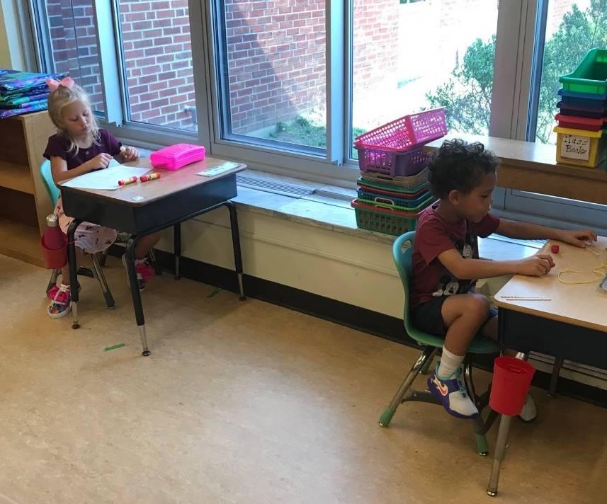 Kindergarteners enjoying a little drawing time photo