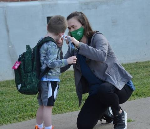 Mrs. Fish sends her son off for his first day of school