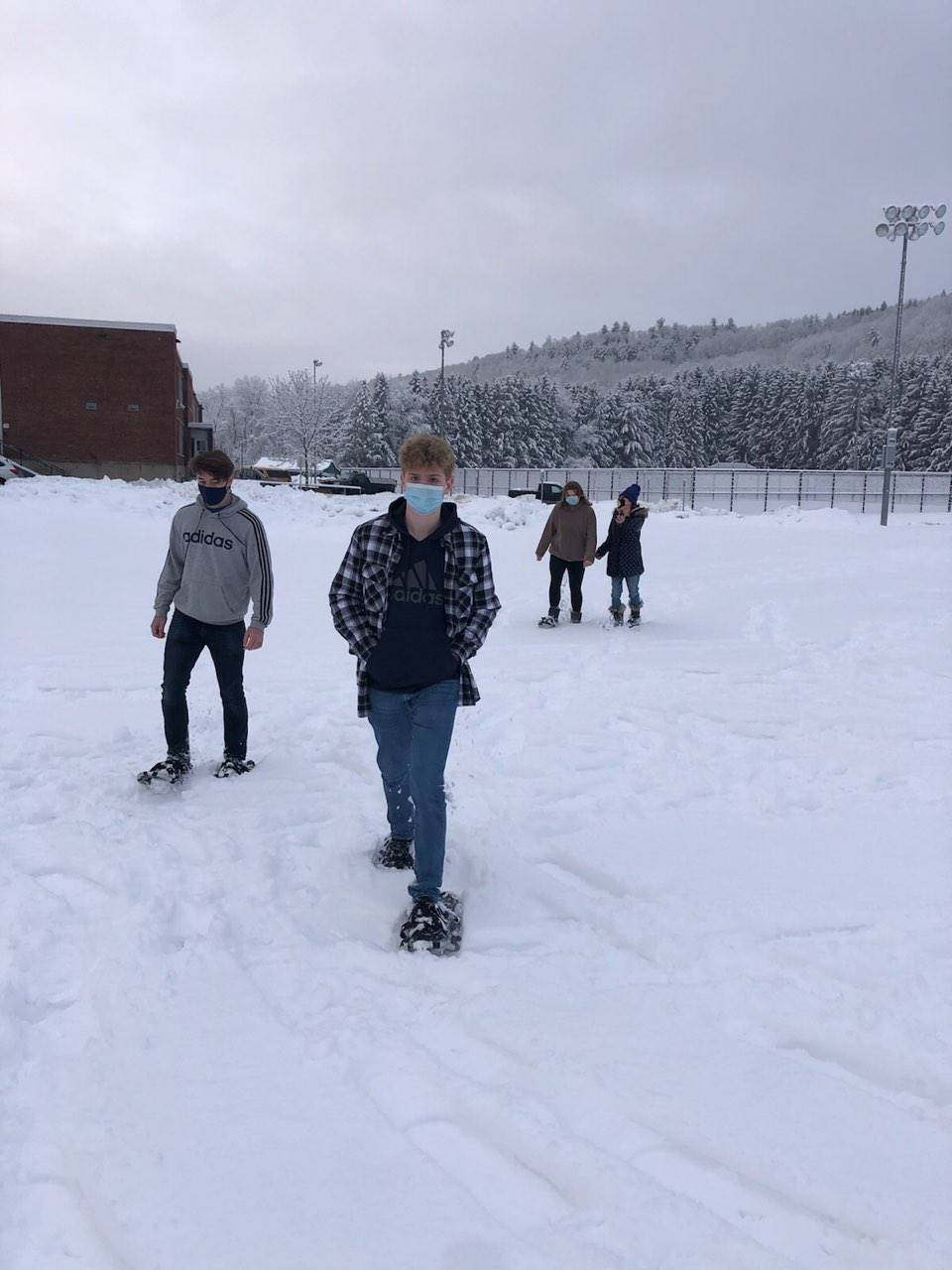 Physical Education students snow shooing photo