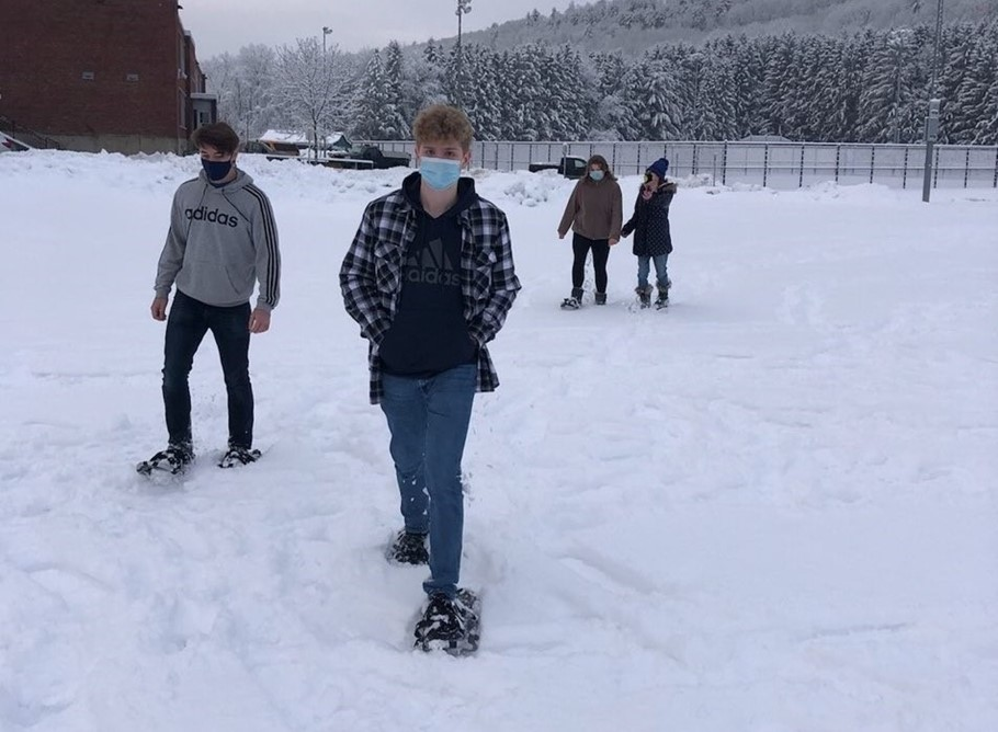 Photo of High School physical education class snow shoeing