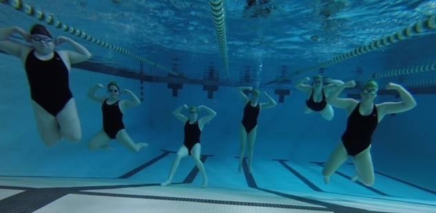 Girls posing underwater