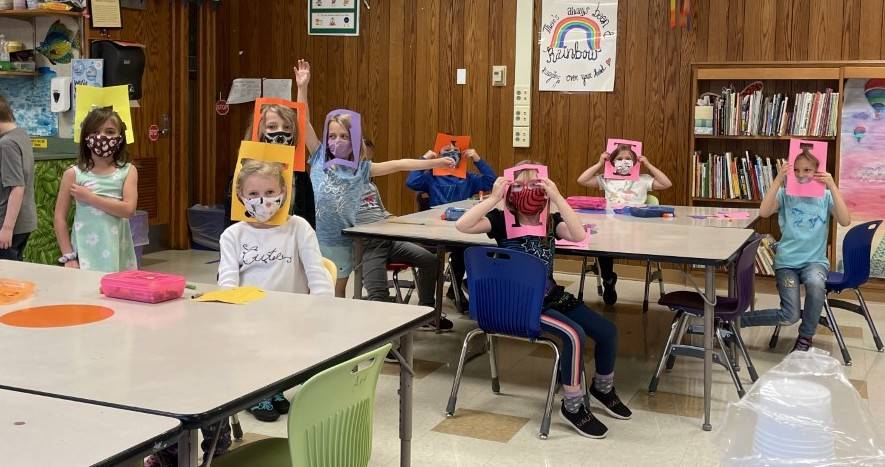 Picture Ms. Carman's art students wearing paper scraps as hats!