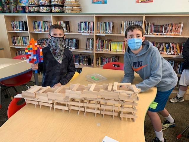 Photo of students with wood project in Intermediate Library