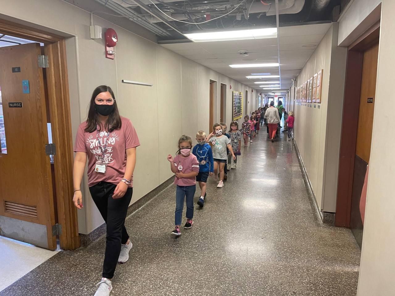 Primary Students Walking Hallway